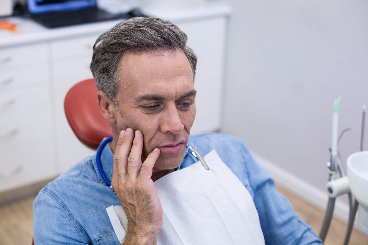 Unhappy man having a toothache